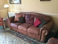 Three seater leather sofa bed + matching two seater