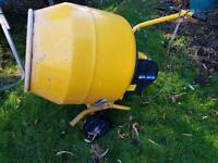 Hardly used concrete mixer with stand