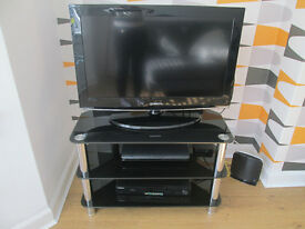 "BLACK GLOSSY GLASS TV STAND WITH CHROME LEGS - 32"" (POSS 34"") GC"