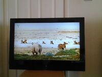 "32"" LCD TV with adjustable wall mount"