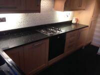 Light beech shaker fitted kitchen