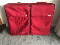 2 large red antler suitcases