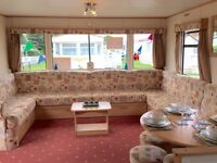 Spacious 8 berth holiday home with decking and site fees