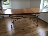 Multiyork French Cherrywood dining table. The Loire collection. Wrought iron stand.