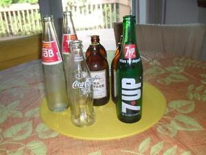 Vintage Coco Cola, 7-UP, and other bottles