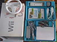 Perfect condition Nintendo Wii with 3 games including Wii Sports. In box with all accessories