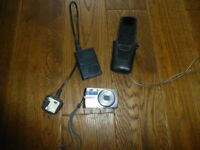 Olympus U1010 digital camera, case & charging unit for spares only as battery doesnt charge anymore