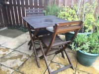 Wooden garden table and 2 chairs.