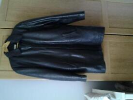 Men's Leather Jackets. 1 black & 1 antique brown bomber style jackets. 1 threequarter black jacket.