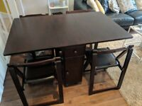 Drop leaf table with four chairs