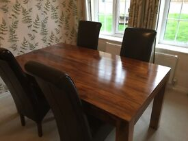 contempory Shesham Dinning table with six leather chairs