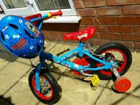 Childs paw patrol bike and helmet