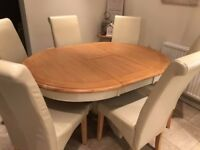 SOLID OAK WOOD Table and 6 fake leather Cream Chairs - just 3 months old