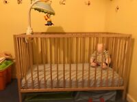 Cot with mattress and mobile