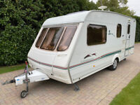 Swift Charisma 560 4 berth 2002 Caravan with Side Dinette and Motor Movers