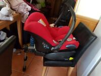 Red Maxi cosi car seat with base