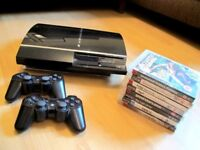 Playstation 3 PS3 with 2 controllers and 8 games