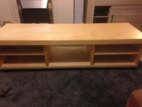 Wooden TV unit with wheels
