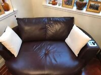 Leather sofa with built in docking station and speakers