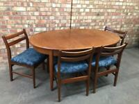 Mid century teak extending dinning table and chairs