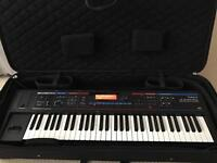 Roland Juno Di Synthesizer with Case