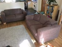 Two chocolate brown 2-seater sofas