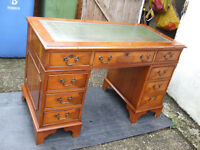 An antique reproduction yew wood veneered pedestal desk 4ft (122 cm) wide approx.