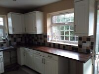 Kitchen units in good condition , with walnut style worktops. Includes Franke sink and taps.