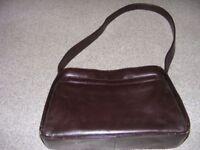 A lovely brown leather plain handbag