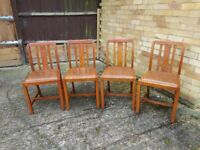 4 matching light oak chairs - good condition