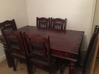 Heavy solid wooden table and 6 chairs