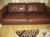 Two seater leather sofa from John Lewis in good condition