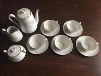 Teapot, milk jug, sugar bowl, cups and saucers
