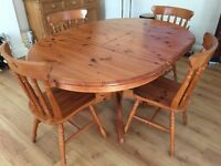 Round Solid Oak extendable dining table and 4 matching chairs