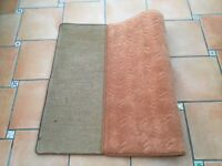 Peach coloured rug