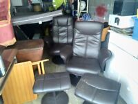 Two reclining chairs with foot stools