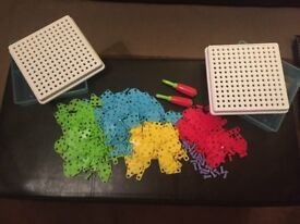 Excellent conditioned large Multi-coloured screw peg boards, pegs, screw drivers and storage tubs