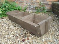 large wooden herb trough