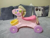 Fisher Price ride on musical pink horse