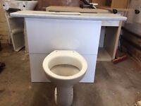 White toilet with concealed cistern in white high gloss unit