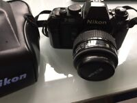 Nikon camera and Nikkor wide-angle lens. Comes in leather Nikon case. £90