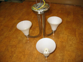 Three glass shade light fitting fits easily to ceiling