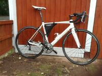 Fuji Altimira 2014 full carbon road bike. Shimano Thiagra gears, Oval handlebars, wheels, and crank