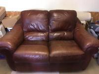 Reddish brown leather settee