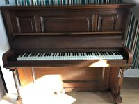 Beautifully kept upright dark wood piano with matching stool. Looking for a new home.