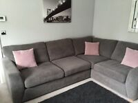 Corner Sofa and Snuggle Chair in Grey immaculate condition separates into two pieces .
