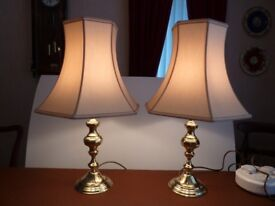 A pair of brass bases complete with cream silk shades