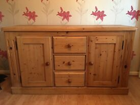 Solid pine sideboard 3 draws and side cuboards with shelfs