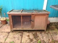 Rabbit hutch with waterproof cover. Good condition