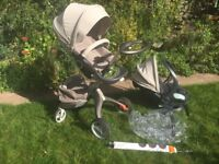 Stokke X-Plory Buggy from 2011. Only used periodically for one year. Rain cover, parasol.